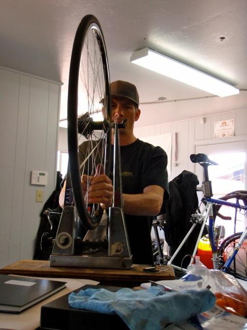 Dave truing up a wheel.