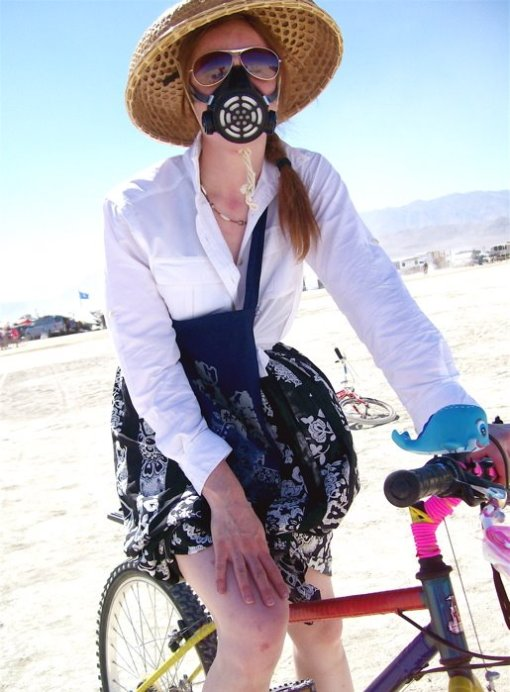 Sarah biking the playa in 2007