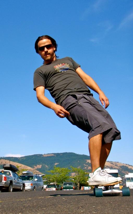 Kurt surfs the parking lot.